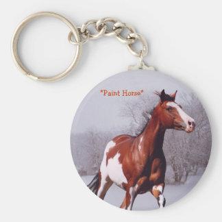 Pinte el llavero galopante de la nieve del caballo