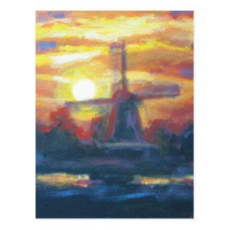 Pintura del molino de viento de la puesta del sol postal