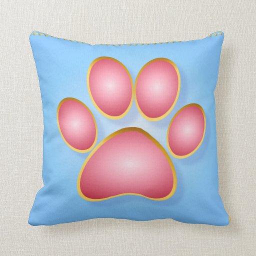 Pique la almohada de la pata del gatito del oro de