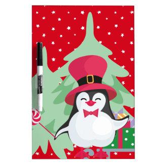 Pizarra Blanca Pingüino festivo con el trineo
