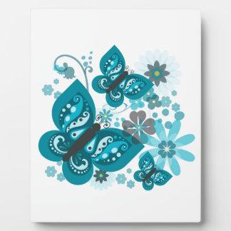 Placa (azul) de las mariposas y de las flores con
