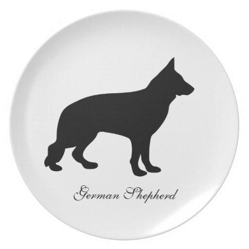 Placa de la silueta del negro del perro de pastor  plato de cena