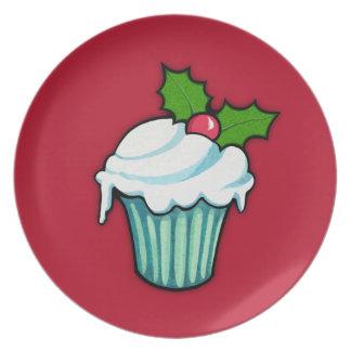 Placa del rojo de la magdalena del acebo del navid plato de comida