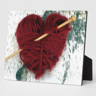 Placa Expositora Corazón rojo de las lanas en la fotografía de la