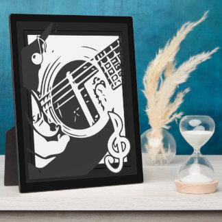 Placa Expositora El jugar de la guitarra del amante de la música