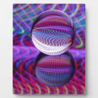 Placa Expositora Mentiras en la bola de cristal