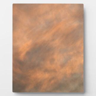 Placa Expositora Puesta del sol a través de las nubes