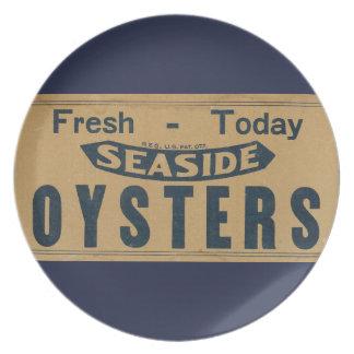 Placa fresca de las ostras plato