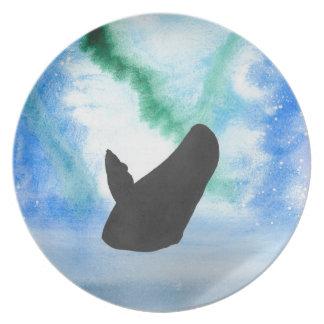 Plato Ballena con la aurora boreal