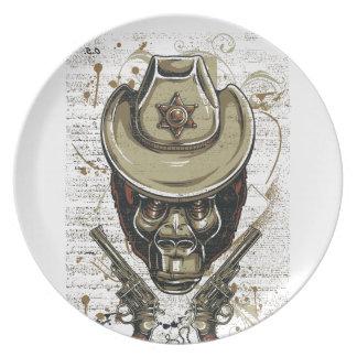 Plato cráneo del vaquero del mono con los armas gemelos