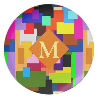 Plato El remiendo colorido acoda el monograma abstracto