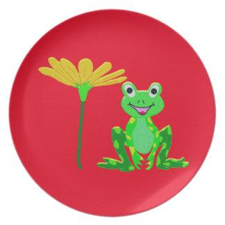 Plato pequeña rana y flor amarilla