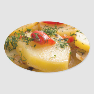 Plato vegetariano de patatas y del paprika pegatina ovalada