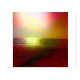 Playa y luz del sol en color postal