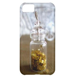 Poca suerte del oro protagoniza en una botella, funda para iPhone 5C