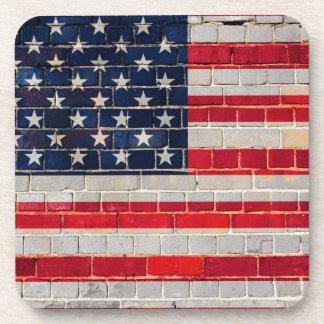 Posavasos Bandera de América en una pared de ladrillo