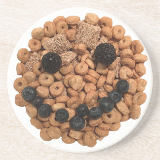 Posavasos De Arenisca Cara sonriente linda de la fruta y del cereal