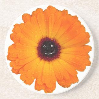 Posavasos De Arenisca Flor anaranjada sonriente