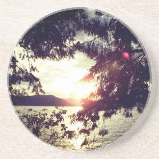 Posavasos De Arenisca Puesta del sol en el horizonte