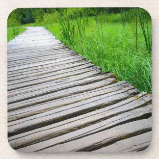 Posavasos Pista de senderismo de madera del paseo marítimo