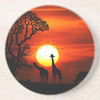 Posavasos Puesta del sol anaranjada en silueta de la jirafa