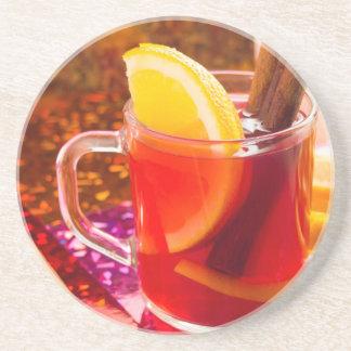 Posavasos Taza transparente de té con la fruta cítrica,