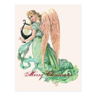 Postal Ángel del navidad con la arpa