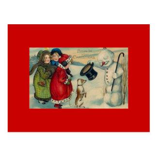 Postal antigua de Navidad en un fondo rojo