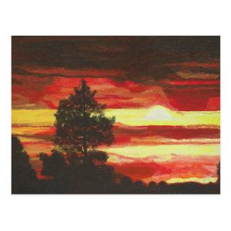 Postal ardiente de la puesta del sol