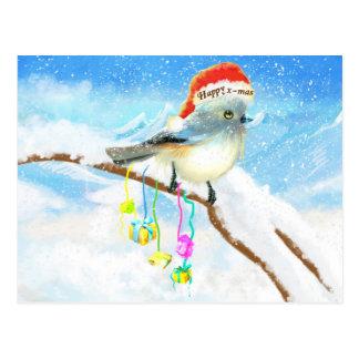 Postal azul feliz del pájaro de Navidad