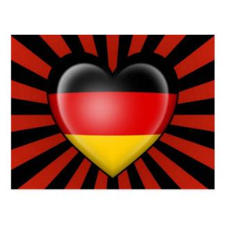 Postal Bandera alemana del corazón con la explosión de la