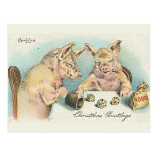 Postal Cerdos del vintage que juegan dados