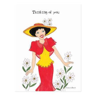Postal Chica en un vestido amarillo y rojo