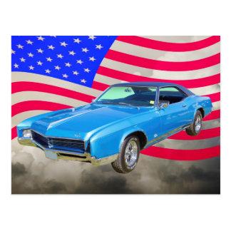 Postal Coche 1967 del músculo de Buick Riviera y bandera
