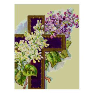 Postal Cruz púrpura con las flores