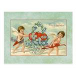 Postal Cupids y corazones del vintage