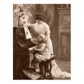 Postal de enseñanza de la música del piano del