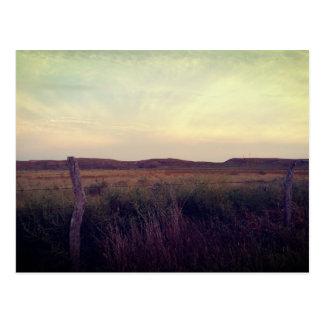 Postal de la pradera de la puesta del sol de