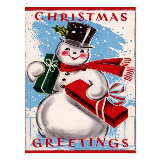 Postal de los saludos del navidad del muñeco de