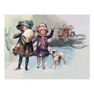 Postal de niñas de Jack Russell felicitando la Navidad