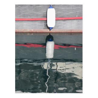 Postal Defensas del barco que cuelgan en el tablero