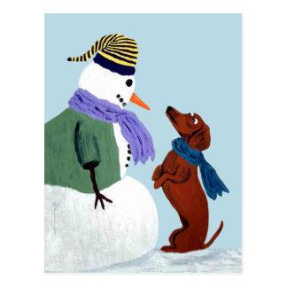 Postal del Dachshund y del muñeco de nieve