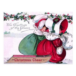 Postal Dos niñas que tiran de un trineo del navidad