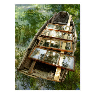 Wooden boat in a bed of rowan leaves postcard