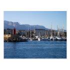 Postal Faro rojo y veleros en el puerto