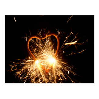Postal Foto macra de un sparkler ardiente en forma de un