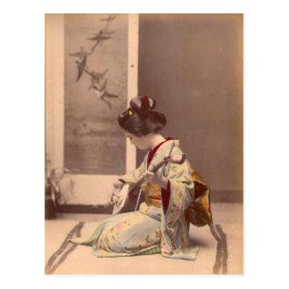 Postal Geisha japonés del vintage que juega el shamisen