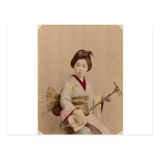 Postal Geisha japonés del vintage que juega Shamisen