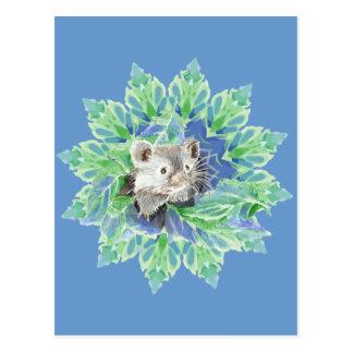 Postal Hámster azul, verde lindo en la cama frondosa para
