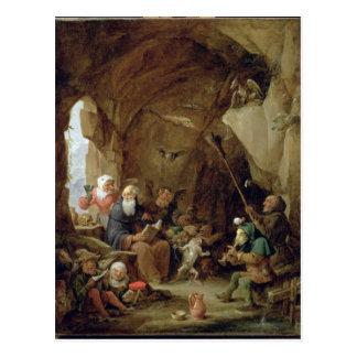Postal La tentación de St Anthony en una caverna rocosa